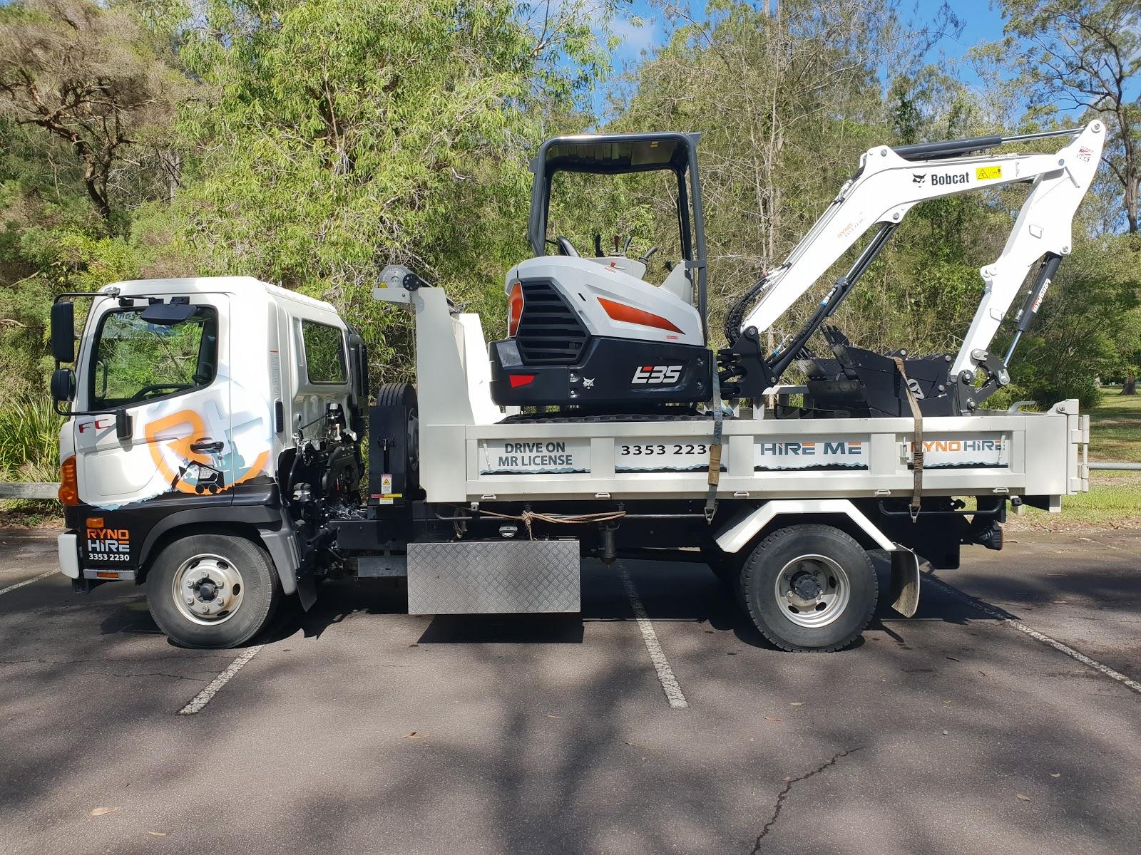 tipper truck towing excavator