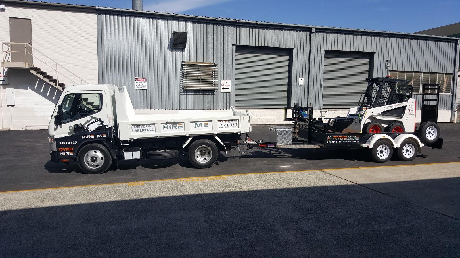 tipper truck towing skid steer loader