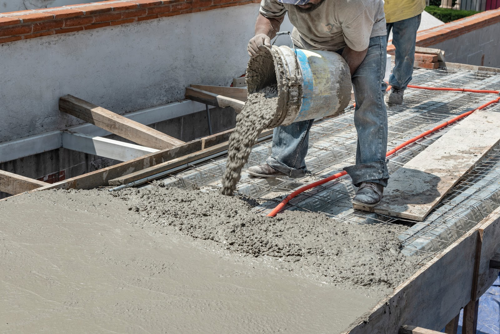 laying concrete on construction site